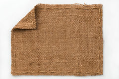 Frame of burlap with curled edges, lies on a white background Royalty Free Stock Image