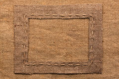 Frame of burlap, lies on a background of burlap Stock Image