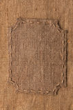 Frame of burlap, lies on a background of burlap Royalty Free Stock Photos