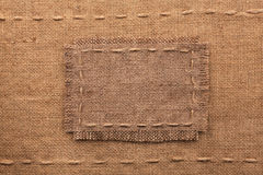 Frame of burlap, lies on a background of burlap Stock Images
