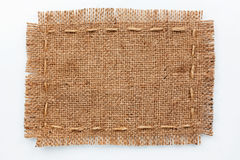 Frame of burlap, lies on a background of burlap  with place for Royalty Free Stock Photography
