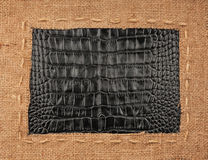 Frame of burlap, lies on a background of leather Stock Images