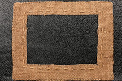Frame of burlap, lies on a background of leather Stock Photography