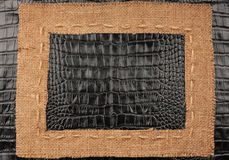 Frame of burlap, lies on a background of leather Royalty Free Stock Image