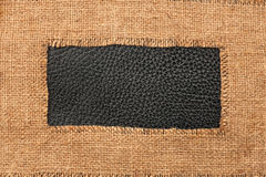Frame of burlap, lies on a background of leather Royalty Free Stock Photos