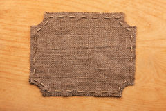 Frame of burlap, lies on a background of wood Stock Photo