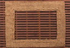 Frame of burlap, lies on a bamboo mat Stock Photos