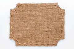 Frame of burlap, lies on a white background Stock Image