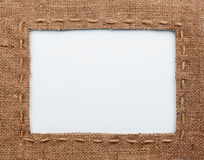 Frame of burlap, lies on a white background Royalty Free Stock Photo