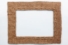 Frame of burlap, lies on a white background Stock Photos