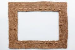 Frame of burlap, lies on a white background Stock Photos