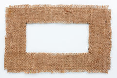 Frame of burlap, lies on a white background Royalty Free Stock Photography