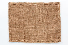 Frame of burlap  lies on a white  background Royalty Free Stock Images