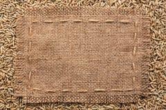 Frame of burlap  lying on a rye background Royalty Free Stock Image