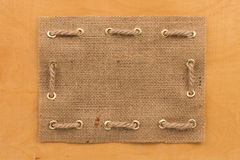 Frame of burlap, lying on  wooden Royalty Free Stock Photography