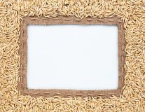 Frame of burlap and  oats  beans Royalty Free Stock Image