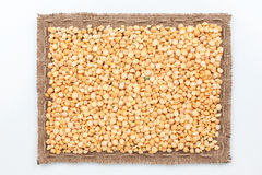 Frame of burlap and  pea seeds Stock Images