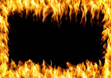 Frame of burning fire. Flame with smoke over black background Stock Photos