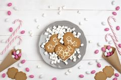 Frame Candies and cookies in the form of heart Top view White wooden Background. Frame colorful Candies, Striped Lollipops and cookies in the form of heart on royalty free stock image