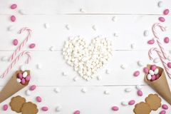Frame Candies, cookies cookies and Marshmallows in the form of h. Frame colorful Candies, Striped Lollipops, cookies and Marshmallows in the form of heart Top royalty free stock photos