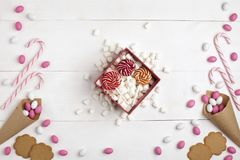Frame Candies, cookies,Marshmallows and Lollipops Gift Top view White wooden Background. Frame colorful Candies, Striped Lollipops, cookies, Marshmallows and Stock Image
