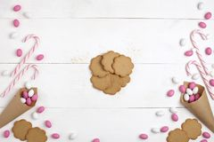 Frame Candies and cookies Top view White wooden Background. Frame colorful Candies, Striped Lollipops and cookies Top view White wooden Background Valentines Day Royalty Free Stock Photo