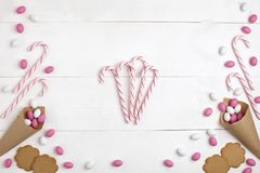 Frame Candies and cookies Top view White wooden Background. Frame colorful Candies, Striped Lollipops and cookies Top view White wooden Background Valentines Day Stock Photos