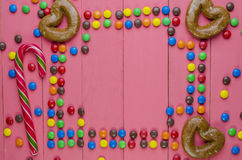 Frame from candies on a pink background royalty free stock image