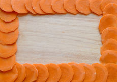 Frame of carrots on a wooden Board Royalty Free Stock Photos