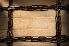 Frame Chain on a Wooden Background Stock Image