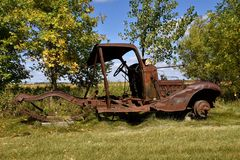 Frame and chassis of an old pickup. Resting on blocks is the rusted frame and chassis of a very old pickup Royalty Free Stock Photography