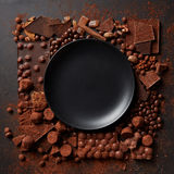 Frame of chocolates with plate Stock Image