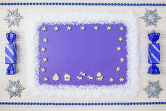 Frame of Christmas accessories and deer on blue wooden background. Top view Royalty Free Stock Images