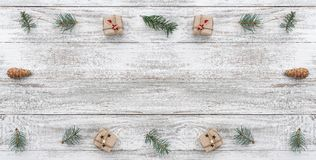 Frame on christmas background of old wood. Fir branches and cones. Xmas items. Top view. Horizontally card.  stock images
