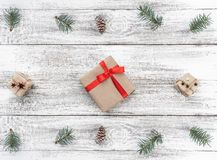 Frame on christmas background of old wood. Fir branches and cones. Xmas items. Top view. Horizontally card.  stock photo