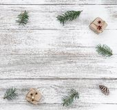Frame on christmas background of old wood. Fir branches and cones. Xmas items. Top view. Square card.  stock image