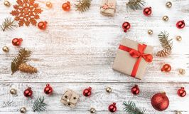Frame on christmas background of old wood. Xmas items. Gift for loved ones and space for greeting cards. Top view. Light effect.  stock image