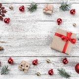 Frame on christmas background of old wood. Xmas items. Gift for loved ones and space for greeting cards. Top view. Square card.  stock images