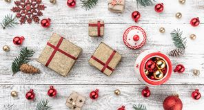 Frame on christmas background of old wood. Xmas items. Gifts for loved ones. Top view. Horizontally Xmas card.  royalty free stock photos