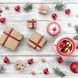 Frame on christmas background of old wood. Xmas items. Gifts for loved ones. Top view. Square card.  royalty free stock photo