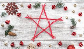 Frame on christmas background of old wood. Xmas items. A star in the middle. Top view. Horizontally Xmas card.  royalty free stock photos
