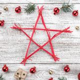 Frame on christmas background of old wood. Xmas items. A star in the middle. Top view. Square card.  royalty free stock photos