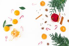 Frame Christmas composition of mulled wine with cinnamon, anise and candy cane on white background. Flat lay, top view Stock Photo