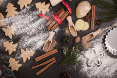 Frame of Christmas cookies and spices over rustic table with cop Royalty Free Stock Photography