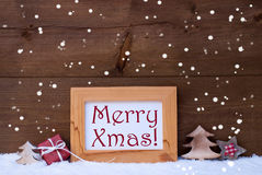 Frame With Christmas Decoration, Snow, Merry Xmas, Snowflakes. Brown Christmas Card With Picture Frame On White Snow With Snowflakes. Red English Text Merry Xmas stock photos