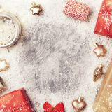 Christmas snowy frame from decorations. Frame from christmas decoration, toys and gifts on snowy grey background, top view, copy space royalty free stock images