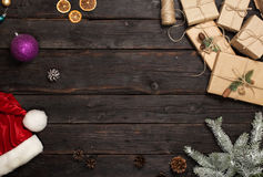 Frame of Christmas gifts, santa hat and branches of fir Stock Image