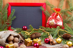 Frame, christmas ornaments and fir cones Stock Images