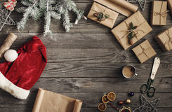 Frame of Christmas Present and santa hat on wooden table Stock Photography