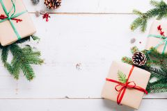 Frame of Christmas presents with natural ornaments royalty free stock photos